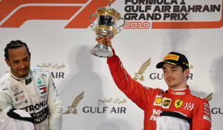 Ferrari's Charles Leclerc (right) finished third at the F1 Bahrain GP as Mercedes's Lewis Hamilton (left) won the race