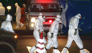 Workers at Fukushima nuclear plant in Japan after radiation leak