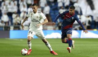 Real Madrid midfielder Dani Ceballos (left) in action against Huesca in La Liga
