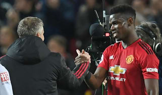 Manchester United caretaker manager Ole Gunnar Solskjaer shakes hands with Paul Pogba