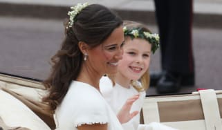 LONDON, ENGLAND - APRIL 29:Sister of the Bride and Maid of Honour Pippa Middleton and bridesmaid Margarita Armstrong-Jones make the journey by carriage procession to Buckingham Palace followi