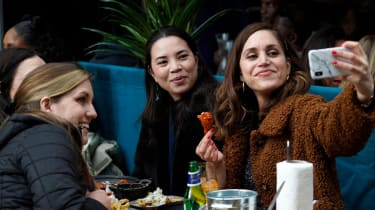 A group of women dine outdoors