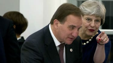 Theresa May speaks with Swedish PM Stefan Lofven at Estonia's summit