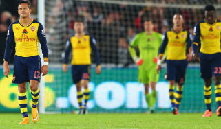 Arsenal players look dejected
