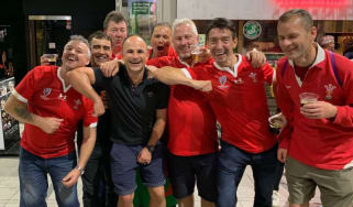 Referee Jaco Peyper was pictured with Wales fans after the match against France