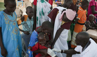 Staff from Medecins Sans Frontieres vaccinate children in South Sudan