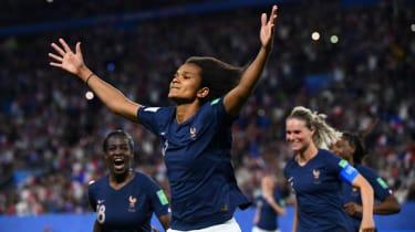 France defender Wendie Renard celebrates after scoring the retaken penalty against Nigeria