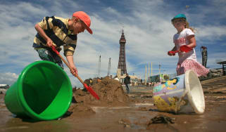Two children play on Blackpool beach