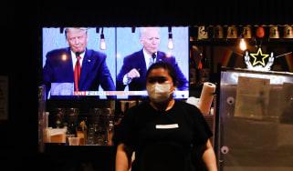 The final debate between President Donald Trump and Joe Biden plays on a restaurant television in Manhattan