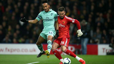 Arsenal striker Pierre-Emerick Aubameyang charged down Ben Foster to score the winner