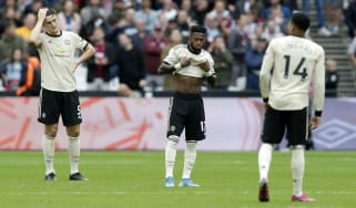 Manchester United players look dejected after West Ham scored their second goal at the London Stadium