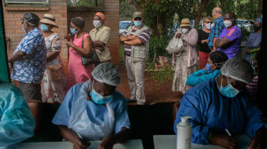Patients queue for a vaccination in Harare, Zimbabwe