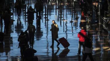 A traveller walks through an airport