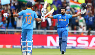 India batsman Rohit Sharma celebrates his century against Pakistan with captain Virat Kohli