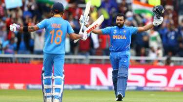 India batsman Rohit Sharma celebrates his century against Pakistan with captain Virat Kohli