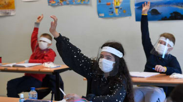 French schoolchildren wearing protective masks
