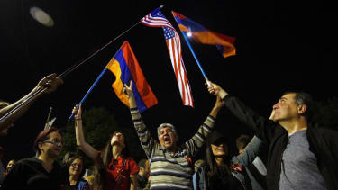 People wave Armenian and US flags in front of the US embassy in Yerevan in April 2021 after President Biden formally designated the slaughter of the Armenians as a 'genocide'