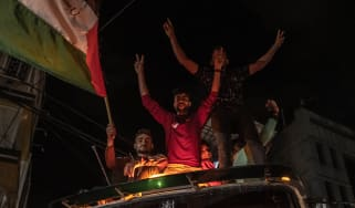 Palestinians in Gaza City celebrate the ceasefire