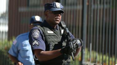 US police officer raising his gun
