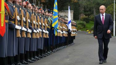 Vladimir Putin and the honour guard