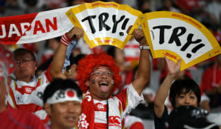 Japan fans hold aloft 'try' signs ahead of the first match