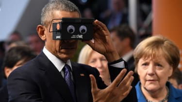 Barack Obama and Angela Merkel test virtual reality glasses during the president's visit to Germany
