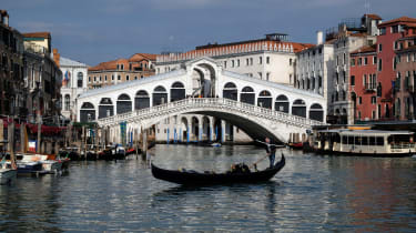 A gondola on an empty Grand Canal in Venice