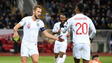 England captain Harry Kane celebrates a goal with fellow striker Marcus Rashford