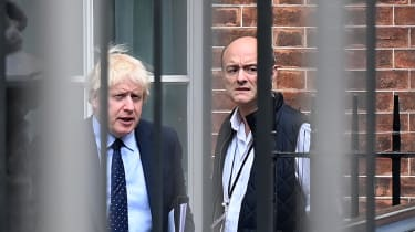 Boris Johnson and his former special advisor Dominic Cummings leave from the rear of Downing Street