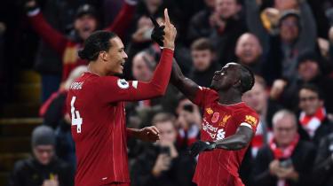 Virgil van Dijk and Sadio Mane celebrate after Liverpool's third goal