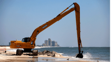 A crane clearing the oil spill