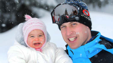 Prince William, Duke of Cambridge (R) poses with his daughter Princess Charlotte (L) during a private break skiing at an undisclosed location in the French Alps on March 3, 2016. / AFP / POOL