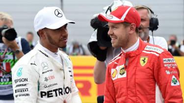 Mercedes driver Lewis Hamilton and his F1 title rival Sebastian Vettel of Ferrari