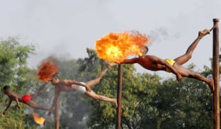 Indian soldiers take part in a fire-breathing demonstration
