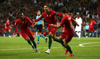 Portugal captain Cristiano Ronaldo celebrates his second goal against Switzerland