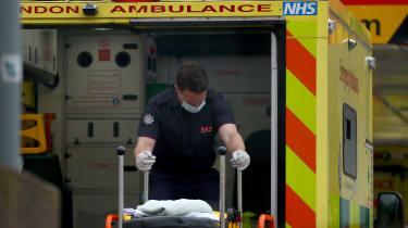 A paramedic moves a stretcher at St Thomas' Hospital, London