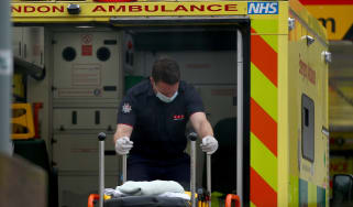 A paramedic moves a stretcher at St Thomas' Hospital, London