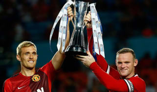 Darren Fletcher and Wayne Rooney lift the International Champions Cup