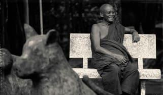 alila_villas_koh_russey_-_destination_-_smiling_monk_in_pagoda.jpg