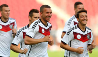 Arsenal's Lukas Podolski and Mesut Ozil train with Germany