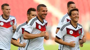 Arsenal's Lukas Podolski and Mesut Ozil train with Germany