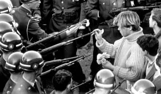 ARLINGTON, VA - OCTOBER 26 1967: Antiwar demonstrators tried flower power on MPs blocking the Pentagon Building in Arlington, VA on October 26, 1967. (Photo by Bernie Boston/The Washington Po