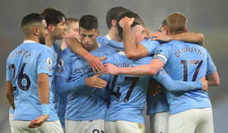 Manchester City players celebrate their goal in the 1-0 win over Brighton on 13 January