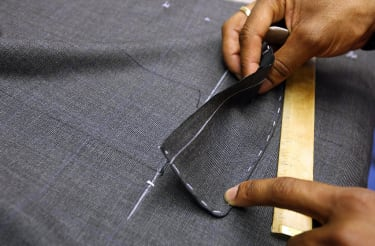 LONDON - AUGUST 19:Bespoke Tailors create suits at Gieves and Hawkes on Saville Row on August 18, 2008 in London, England. A bespoke two piece suit takes up to eight weeks to make and start a