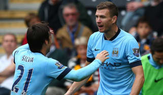 Edin Dzeko of Manchester City celebrates with team-mates after scoring in Hull vs Man City match