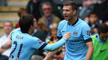 Edin Dzeko of Manchester City celebrates with team-mates after scoring in Hull vs Man City match