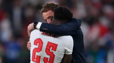 Gareth Southgate consoles Bukayo Saka after England's defeat