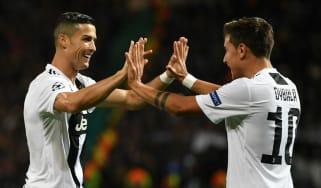 Juventus strikers Paulo Dybala and Cristiano Ronaldo celebrate the winner against Man Utd