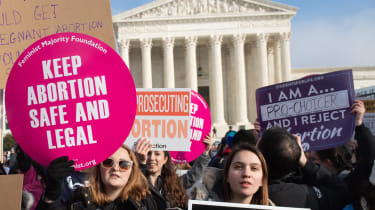 Pro-choice activists protest outside the US Supreme Court