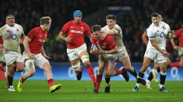 Gareth Anscombe of Wales is tackled by England's Owen Farrell during the 2018 Six Nations clash